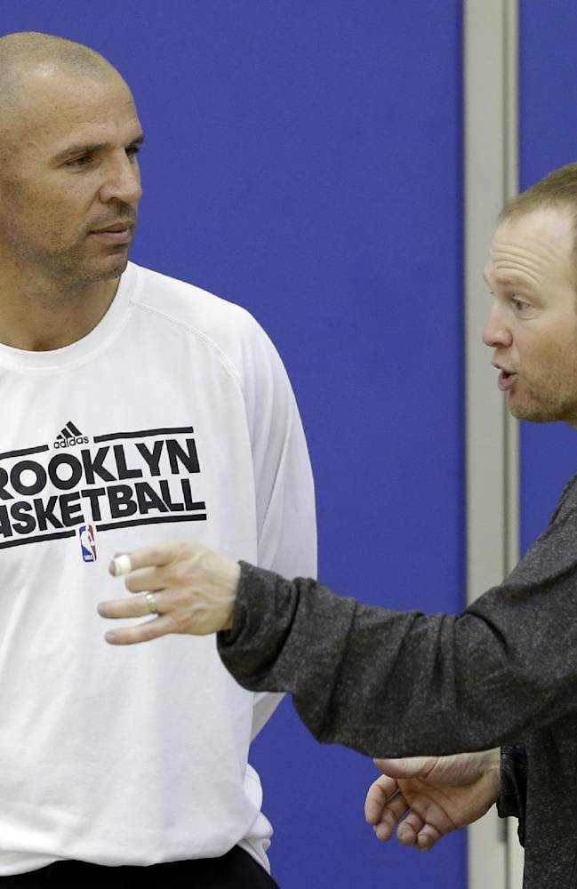 In this Wednesday, Oct. 2, 2013, file photo, Brooklyn Nets coach Jason Kidd, left, and assistant coach Lawrence Frank talk during NBA basketball training camp at Duke University in Durham, N.C. Kidd has been suspended for two games for pleading guilty to driving while ability impaired. The NBA announced on Friday, Oct. 4, 2013, that Kidd will miss the first two games of the regular season starting on Oct. 29