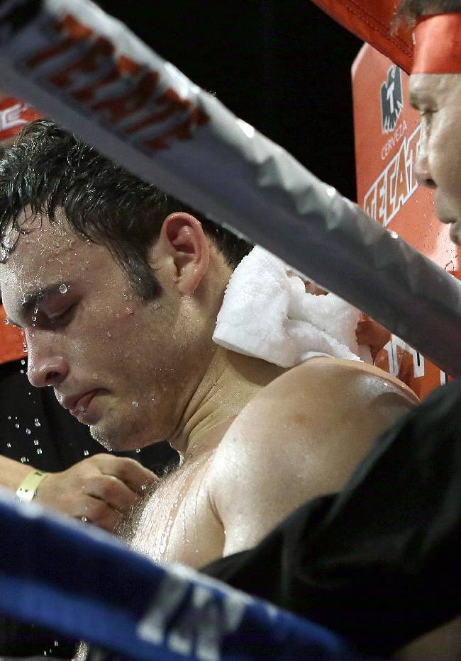 CORRECTS SPELLING OF FIRST NAME TO BRYAN - Julio Cesar Chavez Jr. sits in his corner after the sixth round of a 10-round boxing match between Chavez, the former World Boxing Council (WBC) middleweight champion, and Bryan Vera, the contender, in Carson, Calif., Saturday, Sept. 28, 2013. Chavez won in a unanimous decision