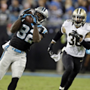 Carolina Panthers' Jerricho Cotchery (82) catches a pass as New Orleans Saints' Marcus Ball (36) defends in the second half of an NFL football game in Charlotte, N.C., Thursday, Oct. 30, 2014 The Associated Press