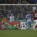 Manchester City's goalkeeper Joe Hart saves on Roma's Francesco Totti, right, during their Champions League, Group E soccer match at Rome's Olympic Stadium, Wednesday, Dec. 10, 2014