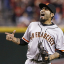In a March 31, 2014, file photo San Francisco Giants' Sergio Romo celebrates the final out against the Arizona Diamondbacks during the ninth inning of an opening day baseball game in Phoenix. A person with knowledge of the negotiations says free agent r