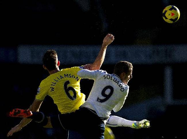 Tottenham Hotspur's Roberto Soldado, right, fights for the ball with Newcastle United's Michael Williamson during their English Premier League soccer match at the White Hart Lane stadium in London, Sunday Nov. 10, 2013