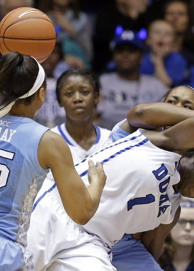 North Carolina's Allisha Gray (15) and Stephanie Mavunga guard Duke's Elizabeth Williams (1) during the second half of an NCAA college basketball game in Durham, N.C., Monday, Feb. 10, 2014. North Carolina won 89-78