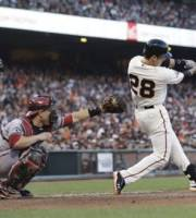 San Francisco Giants' Buster Posey hits a two-run home run against the Arizona Diamondbacks during the fifth inning of a baseball game Saturday, July 20, 2013, in San Francisco. (AP Photo/Marcio Jose Sanchez)
