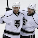 Los Angeles Kings' Jeff Carter (77) celebrates his goal with teammate Drew D1oughty (8) in the first period of an NHL hockey game against the Pittsburgh Penguins in Pittsburgh, Thursday, March 27, 2014 The Associated Press