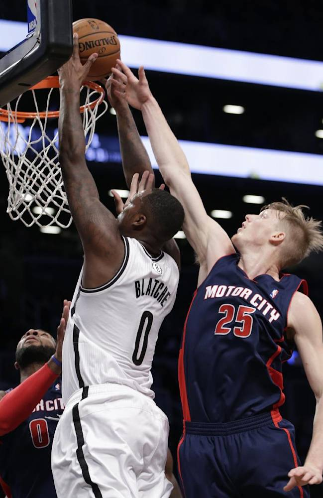 Detroit Pistons forward Kyle Singler (25) tries to block a shot by Brooklyn Nets center Andray Blatche (0) in the first half of an NBA basketball game, Sunday, Nov. 24, 2013, in New York