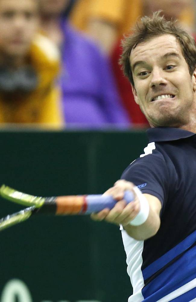 France's Richard Gasquet returns a ball to Russia's Teimuraz Gabashvili during a quarterfinal match at the Kremlin Cup tennis tournament in Moscow, Russia, Friday, Oct. 18, 2013