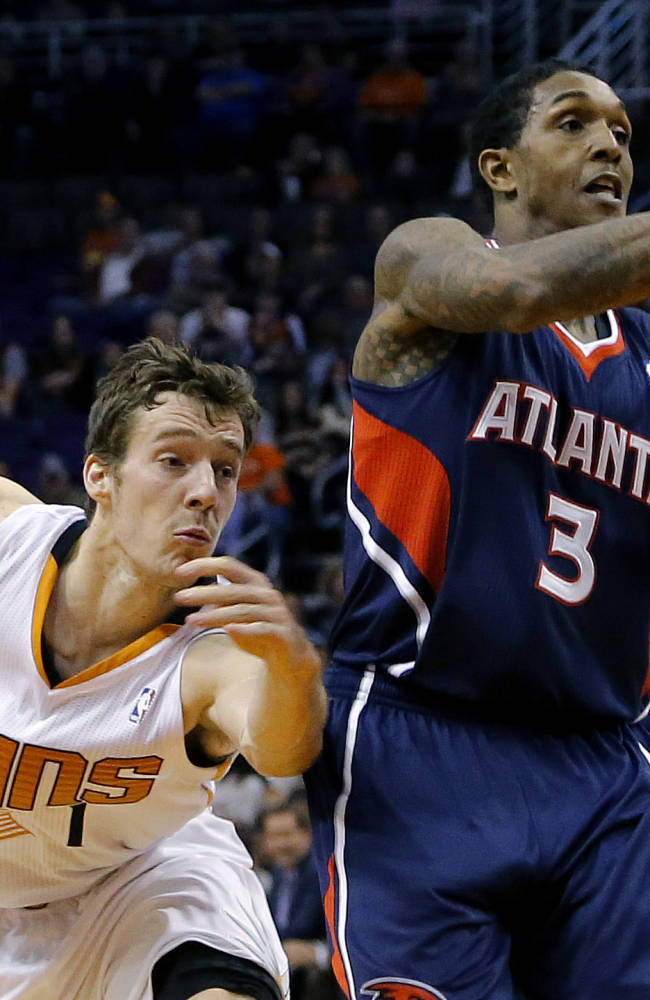 Atlanta Hawks' Louis Williams (3) loses the ball as Phoenix Suns' Goran Dragic, of Slovenia, reaches in during the first half of an NBA basketball game, Sunday, March 2, 2014, in Phoenix