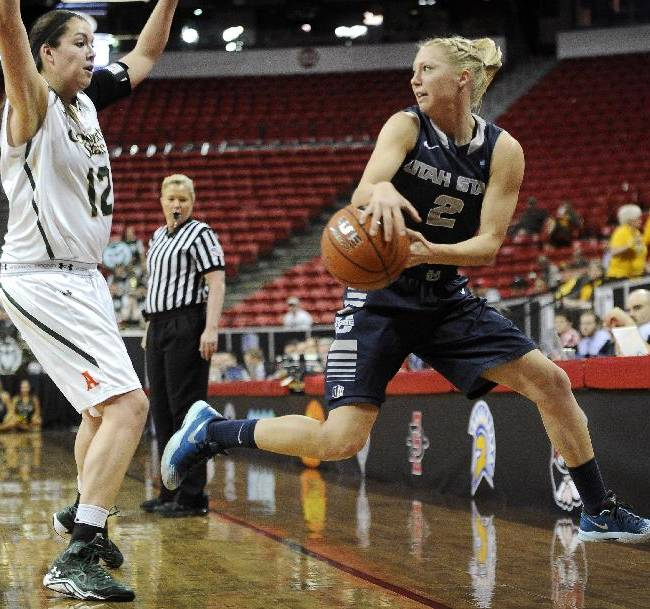 Utah State's Elise Nelson (2) saves the ball from going out of bounds against Colorado State's Sam Martin during the first half of an NCAA college basketball game in the Mountain West Conference women's tournament on Tuesday, March 11, 2014, in Las Vegas