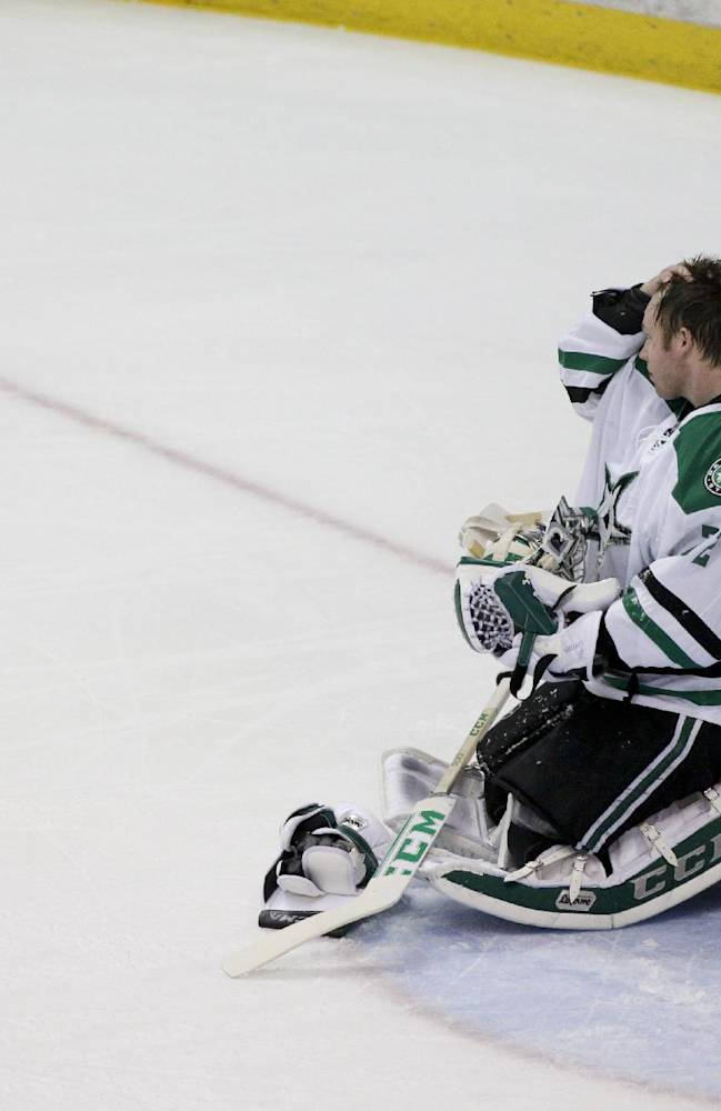 Dallas Stars goalie Kari Lehtonen, of Finland, kneels on the ice after allowing a goal by Anaheim Ducks' Ryan Getzlaf during the first period in Game 1 of the first-round NHL hockey Stanley Cup playoff series on Wednesday, April 16, 2014, in Anaheim, Calif