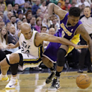 Utah Jazz's Richard Jefferson (24) and Los Angeles Lakers Nick Young (0) battle for a loose ball in the second quarter during an NBA basketball game Monday, April 14, 2014, in Salt Lake City, Utah The Associated Press