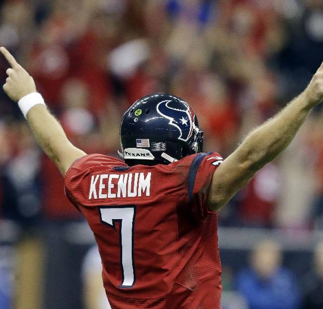 Houston Texans' Case Keenum celebrates teammate Andre Johnson's touchdown during the first quarter of an NFL football game against the Indianapolis Colts, Sunday, Nov. 3, 2013, in Houston
