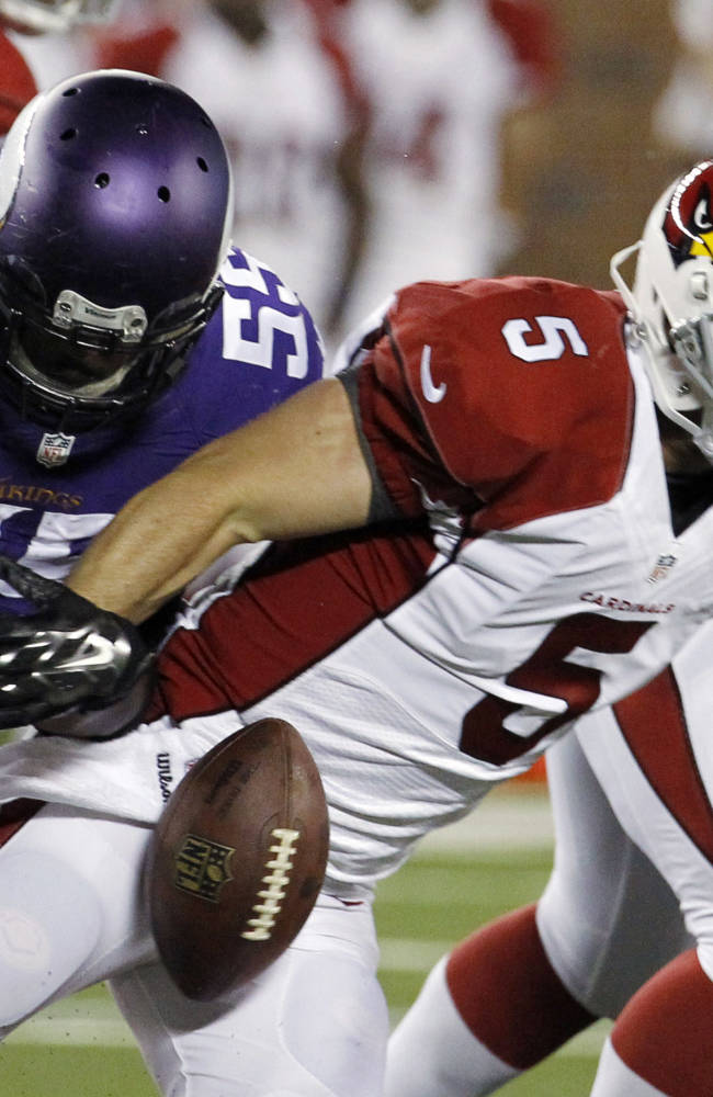 Minnesota Vikings outside linebacker Anthony Barr (55) forces a fumble by Arizona Cardinals quarterback Drew Stanton (5) during the first half of an NFL preseason football game, Saturday, Aug. 16, 2014, in Minneapolis