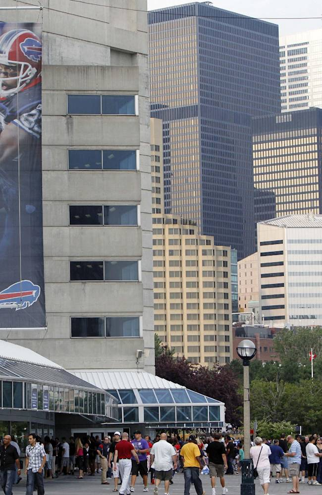 In this Aug. 19, 2012 file photo, fans walk in front of the Rogers Centre before a preseason NFL football game between the Indianapolis Colts and Buffalo Bills in Toronto. The Buffalo Bills play the Atlanta Falcons in a home game at Rogers Stadium on Sunday, Dec. 27, 2013