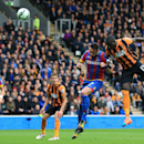 Hull City's Mohamed Diame, right, heads the ball to score during their English Premier League soccer match against Crystal Palace at the KC Stadium, Hull, England, Saturday, Oct. 4, 2014