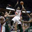 Detroit Pistons' Greg Monroe shoots in traffic during the first half of an NBA basketball game against the Milwaukee Bucks on Saturday, Feb. 9, 2013, in Milwaukee. (AP Photo/Aaron Gash)
