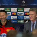 Manchester United's manager David Moyes, right, smiles alongside veteran squad member Ryan Giggs during a press conference at Old Trafford Stadium, Manchester, England, Monday, March 31, 2014. Manchester United will play Bayern Munich in a Champions Leagu