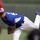 Kansas City Royals starting pitcher Bruce Chen throws during the second inning of a spring exhibition baseball game against the Los Angeles Angels, Thursday, March 20, 2014, in Surprise, Ariz The Associated Press