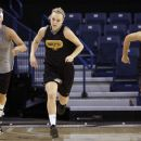 Iowa's Hannah Draxten, left, Jaime Printy, center, and Jade Rogers run during practice in the first round of the NCAA women's college basketball tournament Friday, March 18, 2011, in Spokane, Wash. Iowa plays Gonzaga on Saturday.(AP Photo)