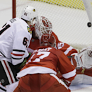 Chicago Blackhawks left wing Garret Ross (61) shoots the puck past Detroit Red Wings goalie Jimmy Howard for a goal during the third period of an NHL hockey game in Detroit, Thursday, Sept. 25, 2014. The Associated Press