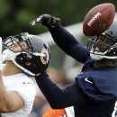 Chicago Bears wide receiver Josh Morgan, right, and cornerback Isaiah Frey try to catch a ball during the team's NFL football training camp Saturday, July 26, 2014, in Bourbonnais, Ill The Associated Press