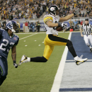 In this Feb. 5, 2006, file photo, Pittsburgh Steelers wide receiver Hines Ward (86) leaps into the end zone past Seattle Seahawks cornerback Marcus Trufant on on a 43-yard touchdown pass from wide receiver Antwaan Randle El in the fourth quarter during th