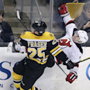 Boston Bruins left wing Matt Fraser (25) upends New Jersey Devils right wing Stephen Gionta (11) on a check during the third period of an NHL hockey game in Boston, Monday, Nov. 10, 2014 The Associated Press
