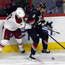 Carolina Hurricanes' Andrej Sekera (4) of Slovakia, battles with Arizona Coyotes' Sam Gagner (9) during the third period of an NHL hockey game in Raleigh, N.C., Saturday, Nov. 1, 2014. Hurricanes won 3-0 for their first win of the season The Associated Pr
