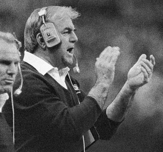 In this Dec. 13, 1982, file photo, Seattle Seahawks head coach Mike McCormack claps his hands while shouting encouragement to his players during an NFL football game against the Chicago Bears in the Kingdome in Seattle. McCormack, a Hall of Fame offensive lineman died Fridaym, Nov. 15, 2013, in Palm Desert, Calif. He was 83. During his nearly 50 years in professional football, McCormack played, coached and held several executive positions