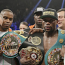 Floyd Mayweather Jr., left, poses with his champion's belts and his father, head trainer Floyd Mayweather Sr., after his victory over Manny Pacquiao, from the Philippines, in their welterweight title fight on Saturday, May 2, 2015 in Las Vegas. (AP Photo/Isaac Brekken)