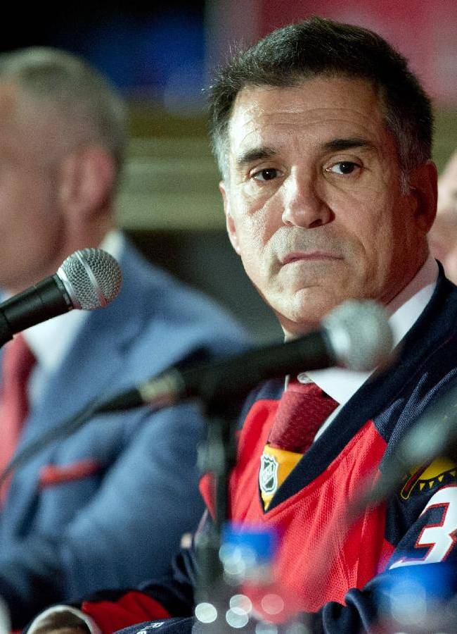 Vincent Viola listens during a news conference Friday, Sept. 27, 2013, in Sunrise, Fla., after he was formally introduced as the new owner of the Florida Panthers NHL hockey team