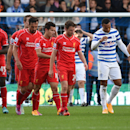 Liverpool players, left, celebrate after Queens Park Rangers' Steven Caulker scored an own goal during their English Premier League soccer match at Loftus Road, London, Sunday, Oct. 19, 2014