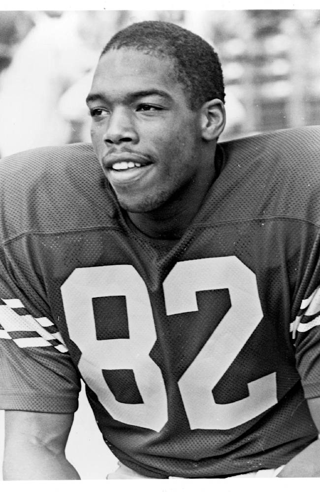 This black and white photo provided Monday, March 31, 2014, by the University of Southern California, shows USC football player Lonnie White. The former player, who worked as a Los Angeles Times sports writer for two decades, has died. He was 49. White died Saturday, March 29 at Glendale Memorial Hospital, his sister Terri told the Times. He'd had a number of health problems in recent years, she said