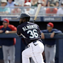 Seattle Mariners' Abraham Almonte follows through on a solo home run off a pitch from Cleveland Indians' Travis Banwart in the first inning of a spring training baseball game, Wednesday, March 5, 2014, in Peoria, Ariz The Associated Press
