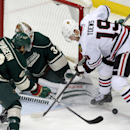 Minnesota Wild's Jared Spurgeon, left, and goalie Niklas Backstrom, of Finland, team up to stop a scoring threat by Chicago Blackhawks' Jonathan Toews in the first period of an NHL hockey game, Thursday, Jan. 8, 2015, in St. Paul, Minn The Associated Pre