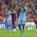 Manchester City's Vincent Kompany applauds to supporters after the Champions League group E soccer match between Bayern Munich and Manchester City in Munich, Germany, Wednesday Sept.17,2014