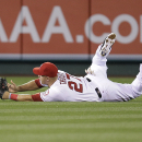 Los Angeles Angels' Mike Trout misses the ball on a two-run single by New York Mets' Anthony Recker during the seventh inning of a baseball game Saturday, April 12, 2014, in Anaheim, Calif The Associated Press