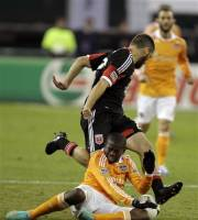 Houston Dynamo's Boniek Garcia, bottom, and DC United's Chris Korb, top, battle for the ball during the first half of the second game of an MLS soccer Eastern Conference semifinal playoff series on Sunday, Nov. 18, 2012, in Washington. (AP Photo/Luis M. Alvarez)