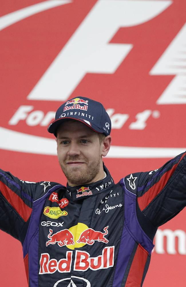 Red Bull driver Sebastian Vettel of Germany celebrates on the podium after winning the Korean Formula One Grand Prix at the Korean International Circuit in Yeongam, South Korea, Sunday, Oct. 6, 2013