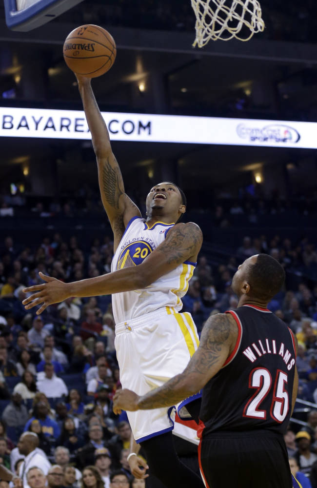 Golden State Warriors' Kent Bazemore (20) shoots over Portland Trail Blazers' Mo Williams (25) during the second half of an NBA preseason basketball game on Thursday, Oct. 24, 2013, in Oakland, Calif