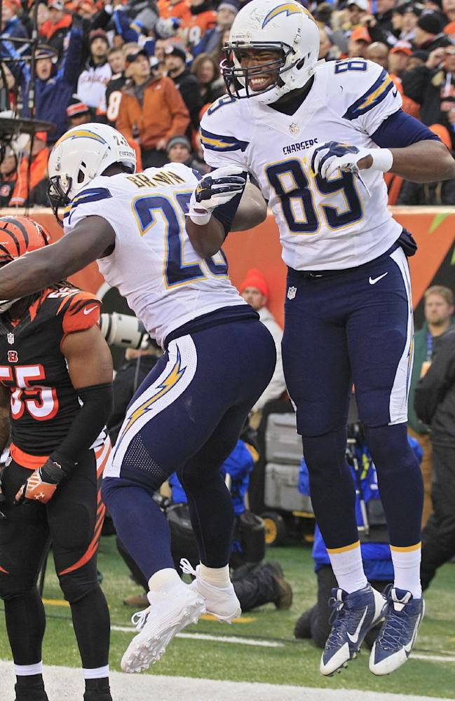San Diego Chargers tight end Ladarius Green (89) celebrates his 4-yard touchdown catch against the Cincinnati Bengals with running back Ronnie Brown (23) in the second half of an NFL wild-card playoff football game on Sunday, Jan. 5, 2014, in Cincinnati