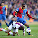 Crystal Palace's Adrian Mariappa, top, is tackled by Aston Villa's Fabian Delph during their English Premier League soccer match at Selhurst Park, London, Saturday, April 12, 2014
