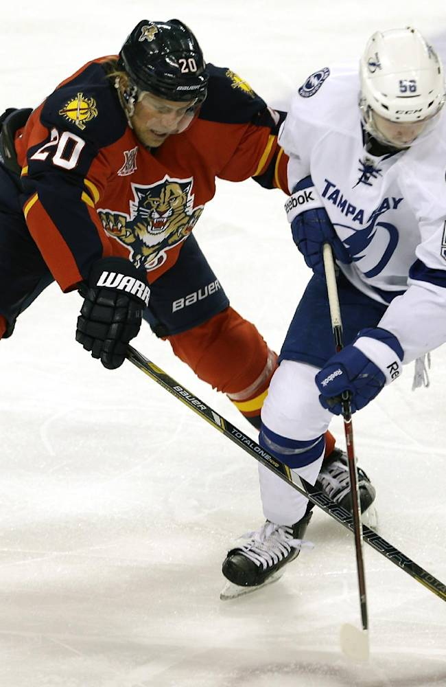 Florida Panthers left wing Sean Bergenheim (20) battles Tampa Bay Lightning right wing Nikita Kucherov (56) for control of the puck during the second period of an NHL hockey game in Sunrise, Fla., Monday, Dec. 23, 2013. Tampa Bay won 6-1