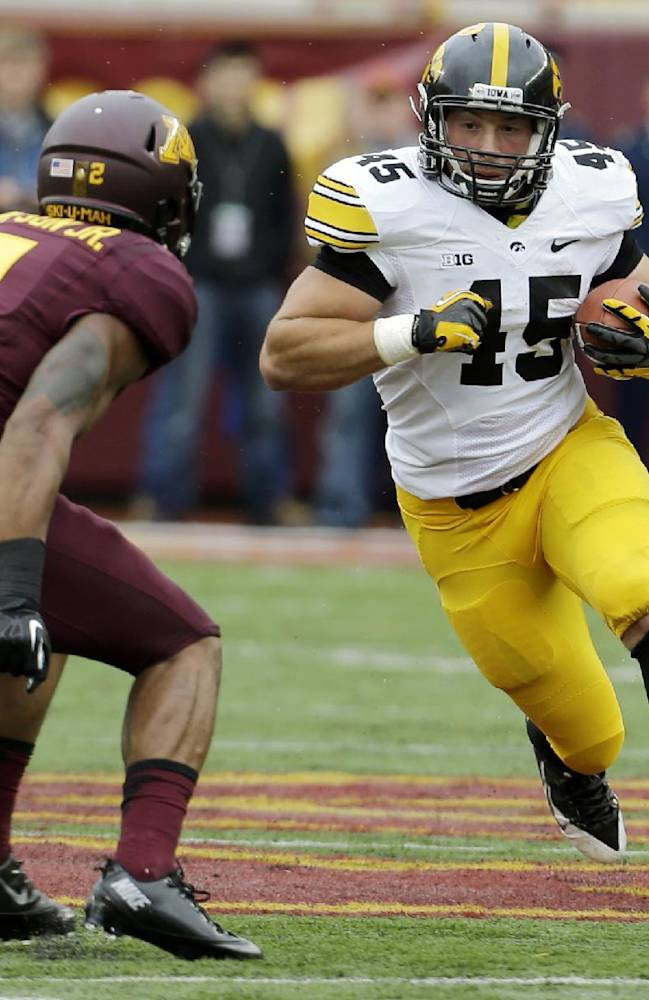 In this Sept. 28, 2013, file photo, Iowa Hawkeyes fullback Mark Weisman (45) carries the ball during the first quarter of an NCAA college football game against Minnesota in Minneapolis. Iowa and Ohio State have had an extra week to get ready for Saturday's game