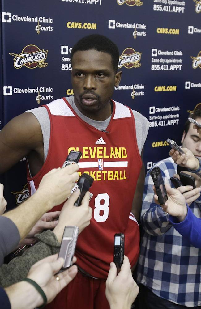 New Cleveland Cavaliers forward Luol Deng talks with reporters after his first practice with the NBA team at their practice facility in Independence, Ohio Wednesday, Jan. 8, 2014. The Cavaliers traded Andrew Bynum and future draft choices for the two-time All-Star Tuesday