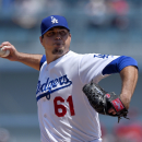 Los Angeles Dodgers starting pitcher Josh Beckett throws to the plate during the first inning of a baseball game against the Arizona Diamondbacks, Sunday, April 20, 2014, in Los Angeles The Associated Press