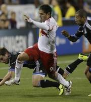 From left, San Jose Earthquakes' Mike Fucito, New York Red Bulls' Juninho (9), and Earthquakes' Justin Morrow (15) chase a loose ball during the first half of an MLS soccer game Sunday, March 10, 2013, in Santa Clara, Calif. (AP Photo/Ben Margot)
