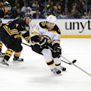 Buffalo Sabres defenseman Tyler Myers (57) and Josh Gorges (4) give chase to Boston Bruins left winger Brad Marchand (63) during the second period of an NHL hockey game in Buffalo, N.Y., Saturday, Oct. 18, 2014 The Associated Press