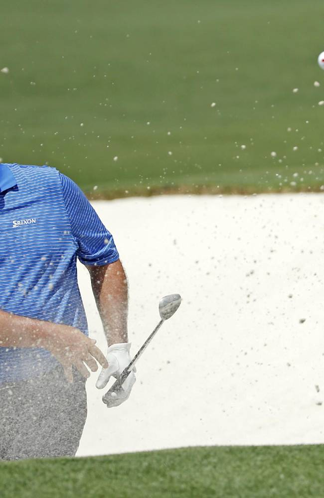 Kevin Stadler hits out of a bunker on the second fairway during the fourth round of the Masters golf tournament Sunday, April 13, 2014, in Augusta, Ga