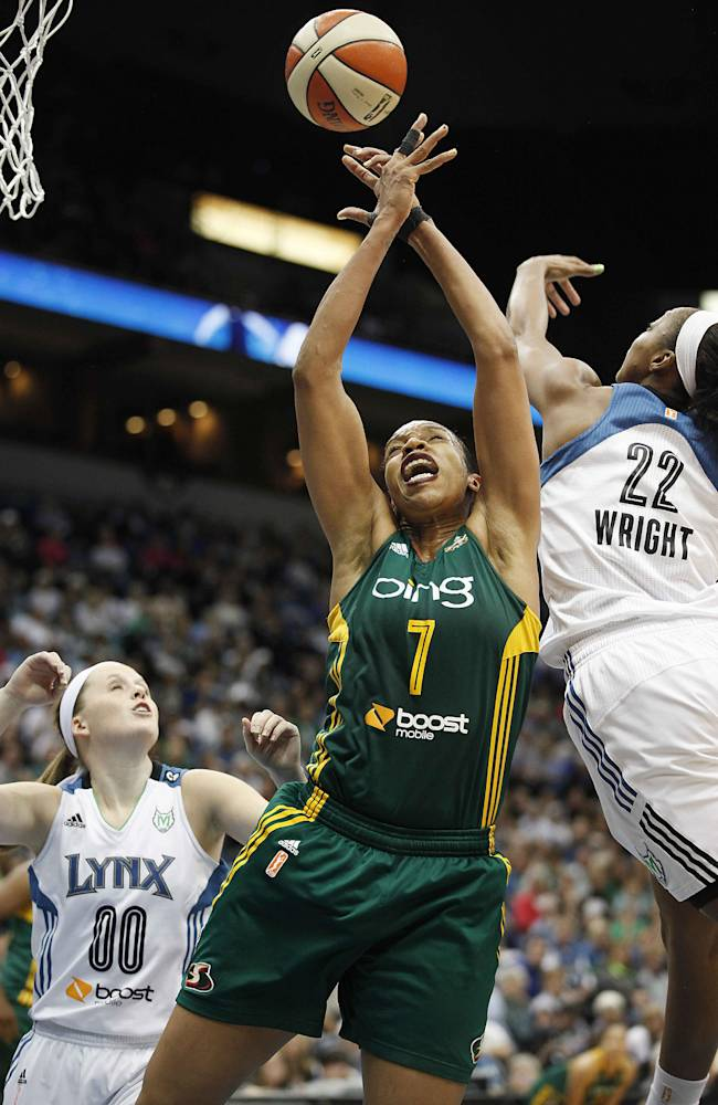 Seattle Storm forward Tina Thompson (7) goes up for a rebound against Minnesota Lynx guard Monica Wright (22) in the opening game of a first-round WNBA basketball playoff series, Friday, Sept. 20, 2013, in Minneapolis. The Lynx won 80-64